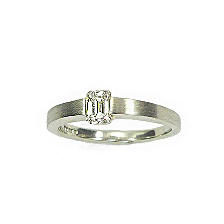 Diamond and platinum Emerald cut Solitaire ring.