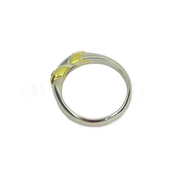Marquise cut diamond in platinum and yellow gold solitaire ring