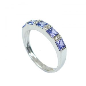 Diamond and tanzanite half eternity ring